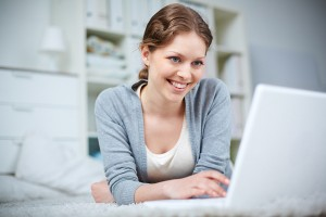 Pretty girl networking on laptop, New Benefits for Accounting Website Clients and Copyright Date